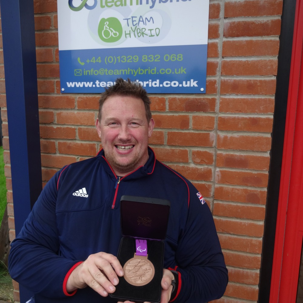 Rob proudly shows his Olympic Bronze